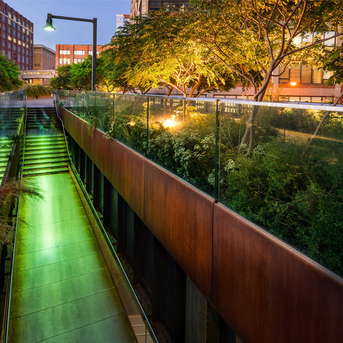 The High Line promenade illuminated at twilight in the West Vill